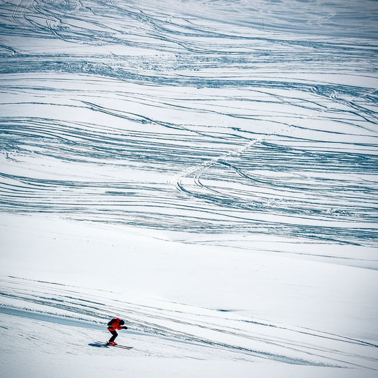 High Angle View Of Person Skiing On Snowy Land During Winter