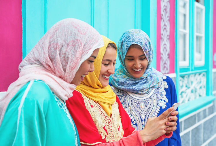 Arabian Arabic Asian  Cell Cellphone Chat Communication Costume Culture Device Dubai Ethnic Friends Generation Girls Group Happy Hijab Indonesian Influencer Instagram Internet Lifestyle Malay Media Millenial Millennial Mobile Muslim Network Online  People Phone Religion Saudi Scarf School Smartphone Social Story Technology Teen Teenager University Using Video Watching Women Young Z