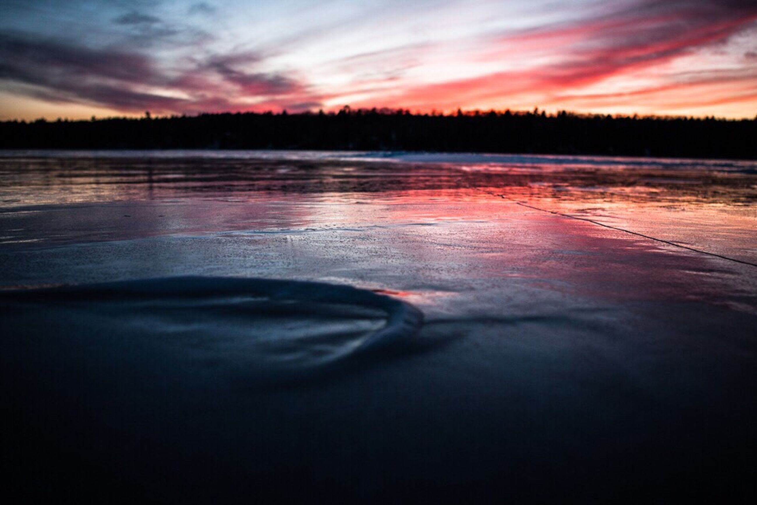 reflection, water, nature, sky, sunset, cloud - sky, outdoors, beauty in nature, lake, tranquility, no people, tranquil scene, scenics, beach, day