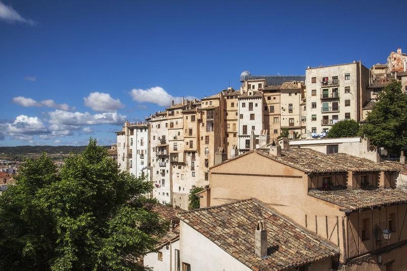 View of residential buildings against blue sky