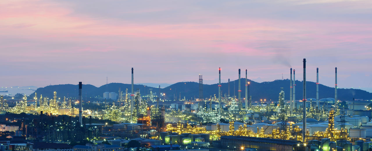 Oil refinery , Petrochemical industrial with city background at sunset , Si Racha District, Chon Buri , Thailand Refinery Sunset Architecture Building Exterior Built Structure Chon Buri City Cityscape Factory Illuminated Industrial Industry Nature Night No People Oil Outdoors Panorama Panoramic Petrochemical Plant Si Racha Sky Sunset