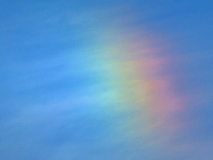 Closeup of a rainbow Closeup Closeup Of Rainbow Refraction Spectrum Multi Colored Blue Rainbow Backgrounds Vibrant Color Sky Cloud - Sky