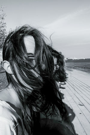 Windy Girl Blackandwhite Light And Shadow Young Women Women Portrait Sky Close-up Tangled Hair