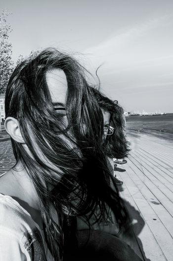 Portrait of woman looking away against sky