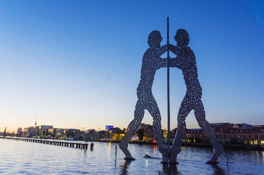 Spree River with Molecule Men and TV Tower Berlin Germany 🇩🇪 Deutschland Molecule Men Spree River Berlin TV Tower Architecture Bridge - Man Made Structure Building Exterior Built Structure City Cityscape Clear Sky Color Image Day Nautical Vessel No People Outdoors River Sky Sunset Travel Destinations Water