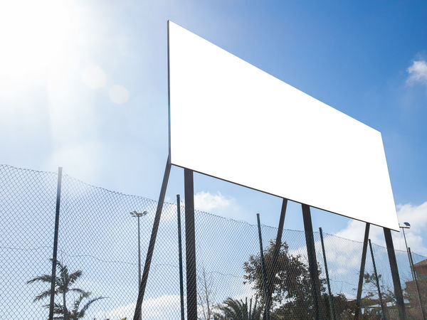 Big Empty Billboard on sunny day Ad Advertisement Advertisement Posters Advertising Advertising Space Announcement Banner - Sign Billboard Board Clear Sky Copy Space Day Empty Marketing Media Message No People Outdoors Outside Panel Promotion Sign Signboard Sky Urban