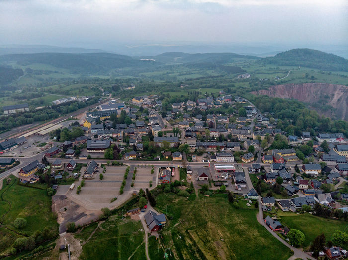 Aerial View Architecture Beauty In Nature Building Building Exterior Built Structure City Cityscape Day Environment High Angle View Landscape Mountain Mountain Range Nature No People Outdoors Plant Residential District Scenics - Nature Sky Town TOWNSCAPE