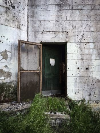 A rustic door from an abandoned industrial building in downtown Lynchburg Virginia Door Entrance Doorway No People Grass Built Structure First Eyeem Photo