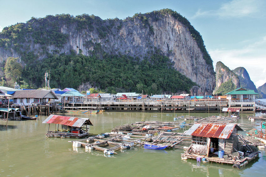 Koh Panyi (Koh Panyee) is a touristic village or Floating Sea Gypsy Village in Phang Nga Province, Thailand, near James Bond Island. Notable for being built on stilts by Indonesian fisherman. Floating Village Gigantic Limestone Rocks Gypsy Island Island Life Jungle-covered Islands Ko Panyi Koh Panyee Koh Panyi Landscape Landscape_Collection Limestone Panyee Island Phangnga Phuket Thailand Thailand_allshots Tourist Destination Tranquility Travel Destinations Travel Photography Traveling Village Village Life Village View