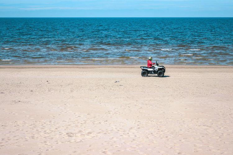 Man riding motorcycle on beach
