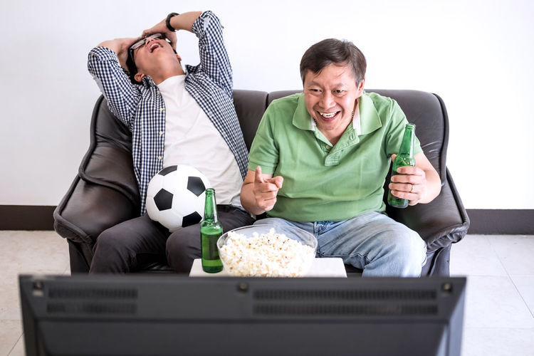 Friends Watching Soccer On Tv