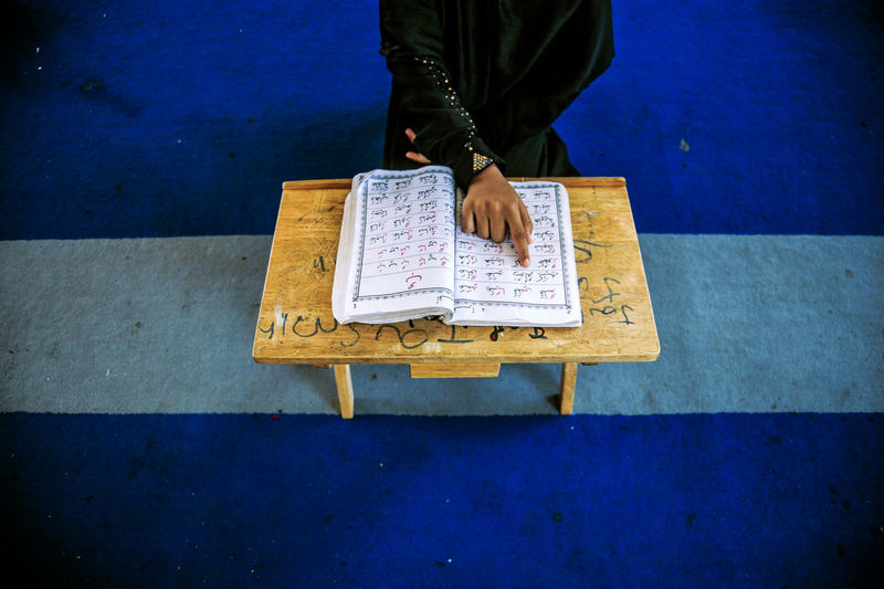 A Muslims Rohingya read the Koran inside the Madrasah (Religious School) during the holy month of Ramadan on June 9, 2016 in Klang, Malaysia. Photo by Samsul Said. Islamic Koran Ramadan  Religious