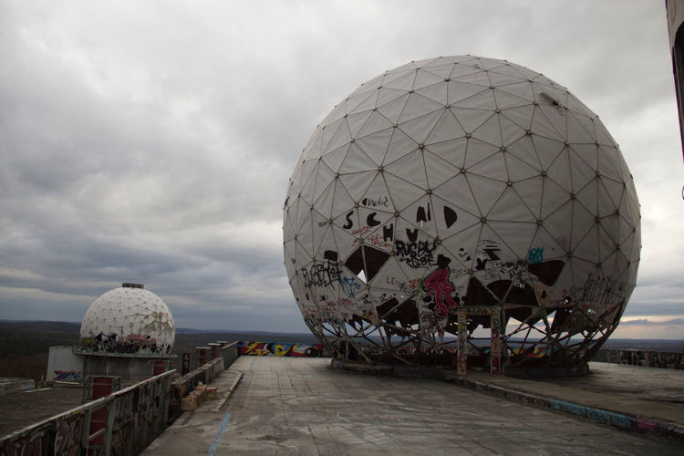 Dome at teufelsberg against cloudy sky