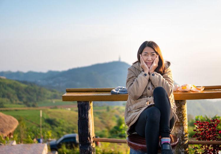Asian women sit