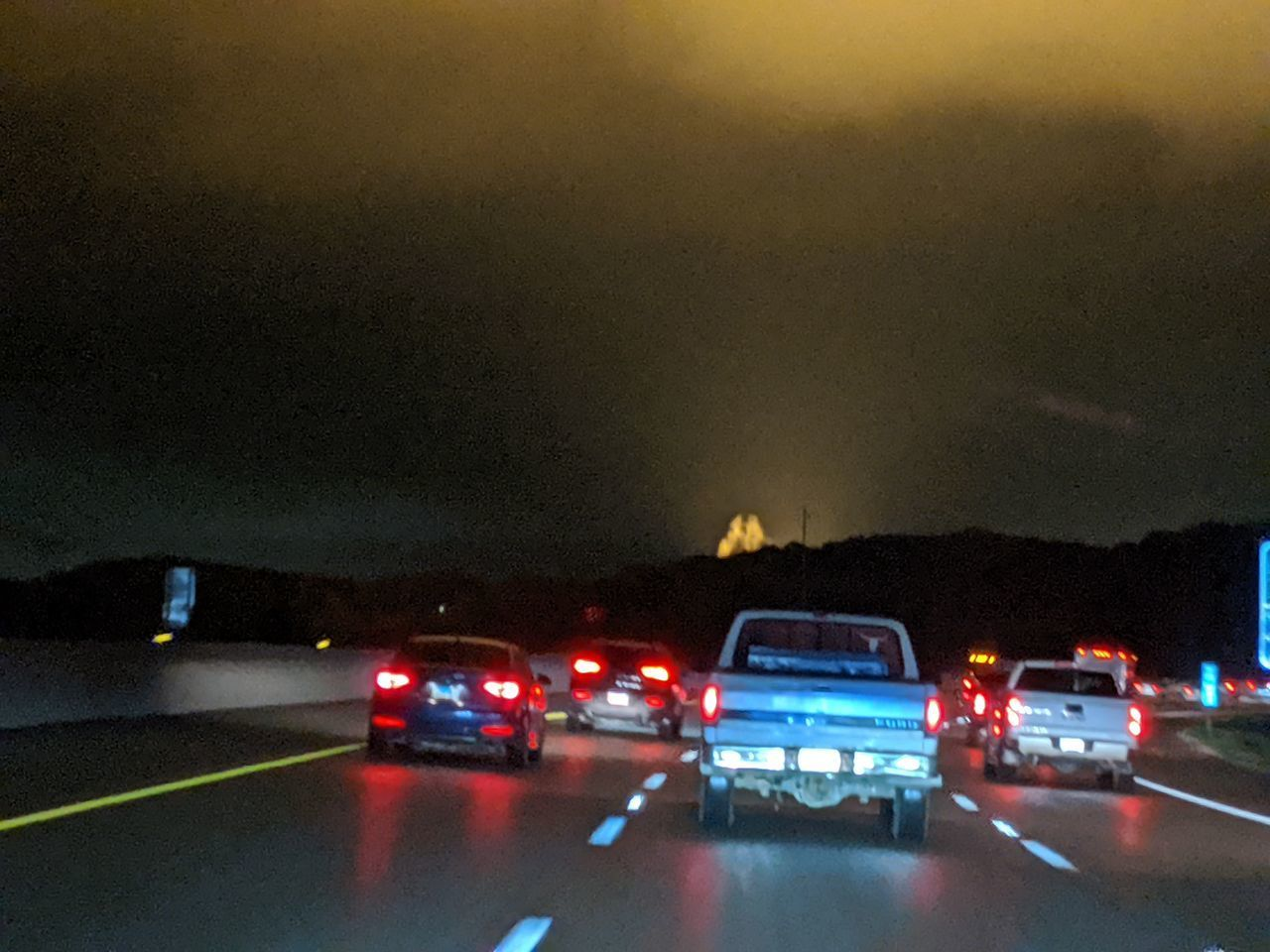 car, transportation, illuminated, motor vehicle, mode of transportation, land vehicle, night, city, street, road, architecture, no people, nature, accidents and disasters, tail light, motion, sky, on the move, outdoors, glowing