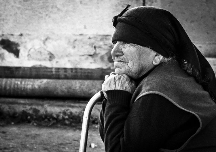 Thoughtful Senior Woman Wearing Warm Clothing
