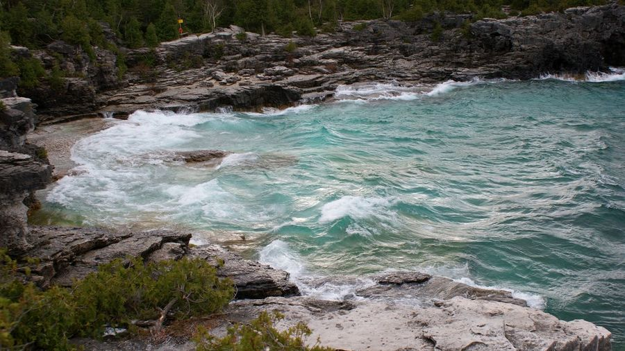 rocky waves at Bruce Peninsula Blue Wave Rocky Bay Beauty In Nature Blue Water No People Outdoors Rock - Object Scenics Sea Travel Destinations Water Wave
