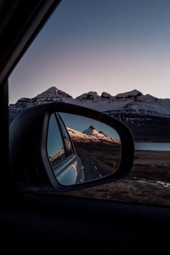 follow the mountain roads Iceland Roadtrip Road Trip Reflection Car Mirror Mirror Sunset Sunset_collection Pastel Car On The Road Water Mountain Cold Temperature Winter Mountain Range Sky Snow Covered Snowcapped Mountain Skyline Rocky Mountains