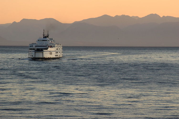 ferry driving towards you EyeEm Best Shots Transport Beauty In Nature Day Eye4photography  Ferry Horizon Over Water Mode Of Transport Mountain Mountain Range Nature Nautical Vessel No People Outdoors Sailing Scenics Sea Sky Sunset Tourism Transportation Travel Destinations Water Waterfront White Boat