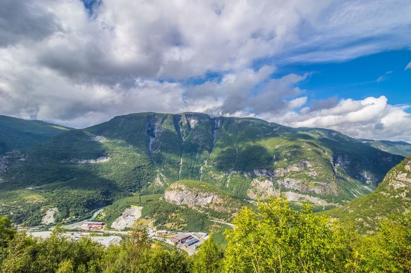 Sky Beauty In Nature Nature Cloud - Sky Scenics Mountain Tranquility Landscape Tranquil Scene No People Day Outdoors Tree Mountain Range Architecture øvre Årdal Norway