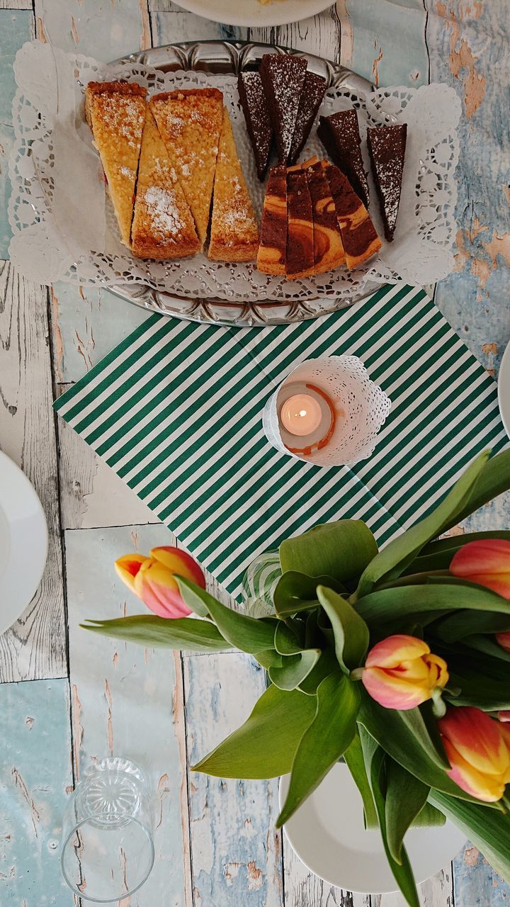 freshness, flower, table, food and drink, food, plant, still life, high angle view, no people, flowering plant, directly above, leaf, plant part, nature, indoors, ready-to-eat, plate, pattern, fork, eating utensil, flower head, flower arrangement, temptation