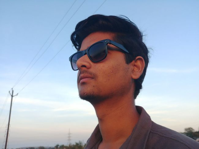 EyeEm Selects Sunglasses Adults Only Headshot Adult Sky One Person One Man Only Young Adult Only Men Low Angle View People Cloud - Sky Day One Young Man Only Outdoors Nature City