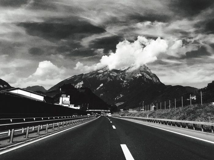 The Way Forward Road Mountain Cloud Sky Cloud - Sky Mountain Range Cloudy Outdoors Marco Knittikus Road Marking Forward Highway Drama Dramatic Sky Dramatic