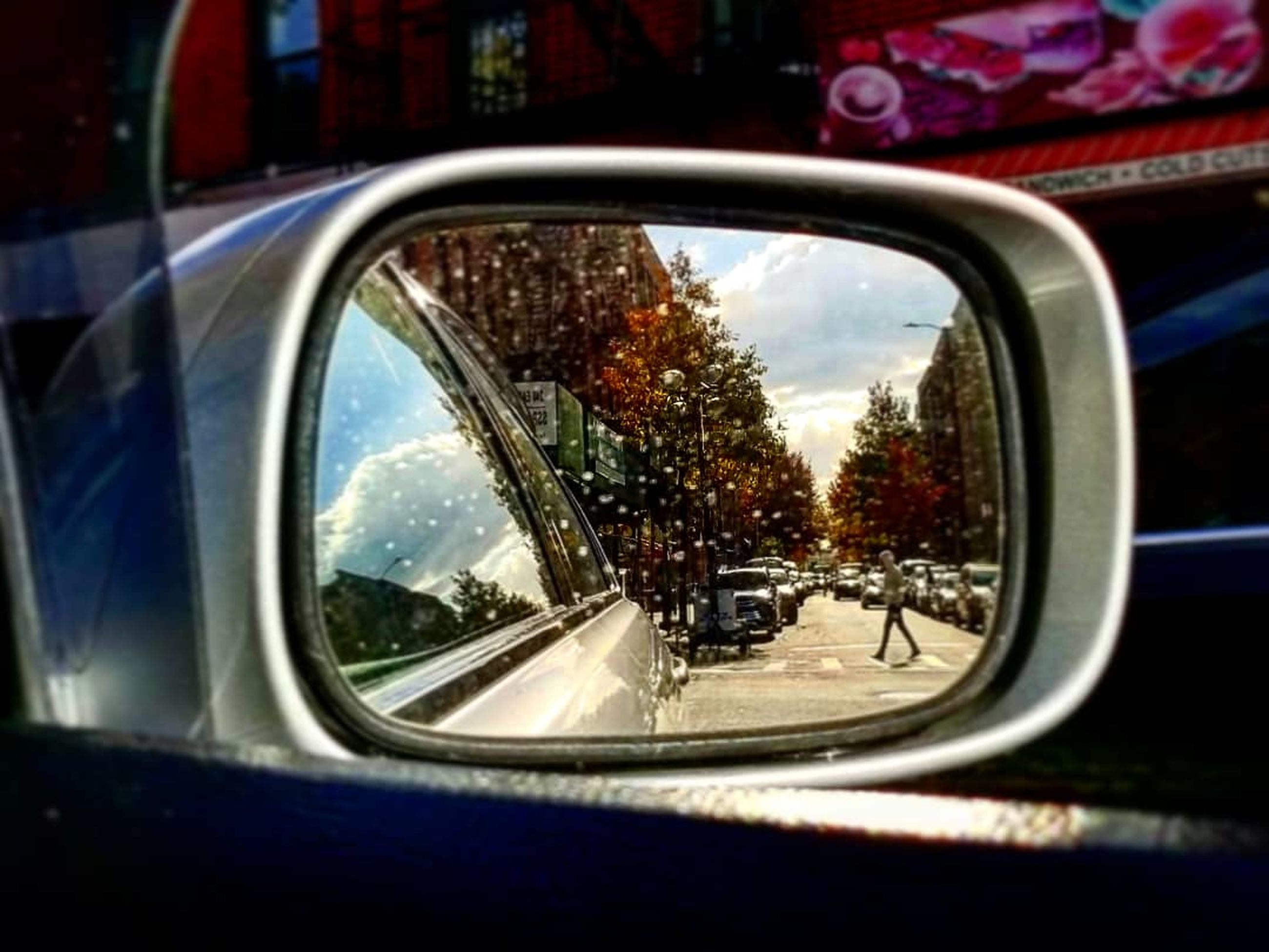 mode of transportation, car, transportation, motor vehicle, land vehicle, side-view mirror, reflection, mirror, close-up, road, city, day, no people, glass - material, window, tree, nature, rear-view mirror, outdoors, travel, vehicle mirror