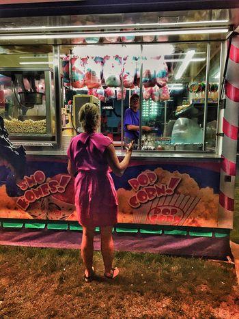 Ella intenta explicar a la vendedora que mucha azúcar hacer daño One Person Women Real People Standing Rear View Full Length Night