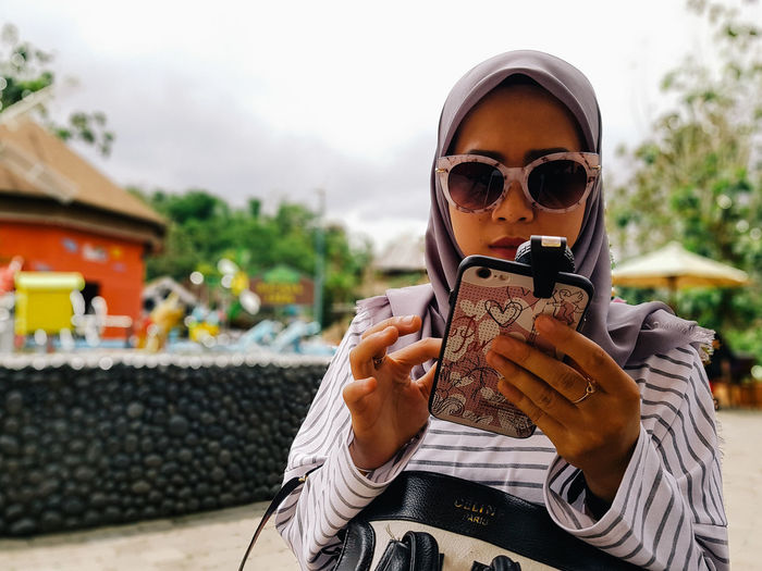 EyeEm Selects Sunglasses One Person Front View Outdoors Day People Happiness Smiling Young Adult Portrait Adult Real People One Woman Only Human Body Part Only Women Adults Only One Young Woman Only Sky Hijab Hijabdaily