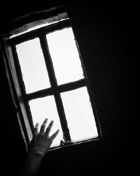 Low section of person against sky seen through window