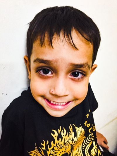 That smile EyeEm Selects Portrait Looking At Camera One Person Headshot Front View Child Smiling Childhood Indoors  Real People Lifestyles Close-up Wall - Building Feature Human Face Emotion Innocence Casual Clothing Happiness