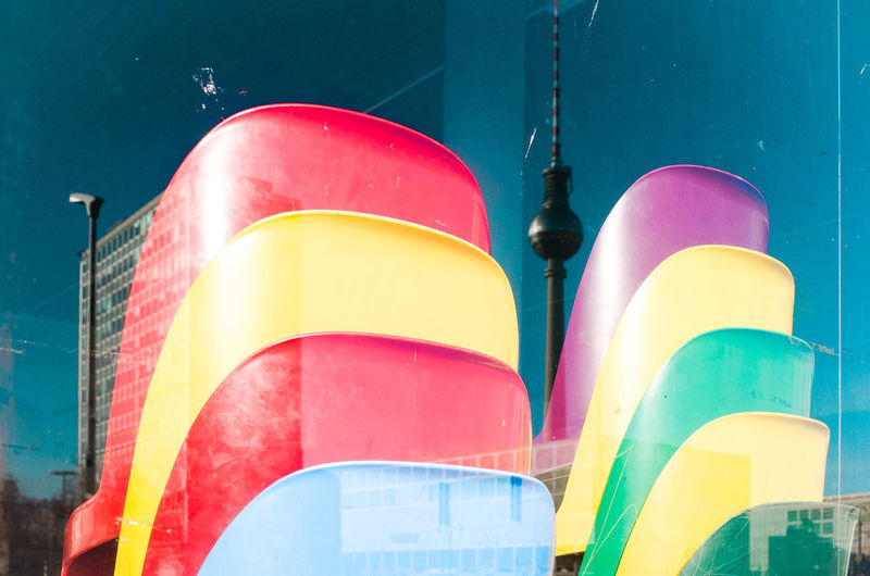 Low angle view of multi colored building against blue sky