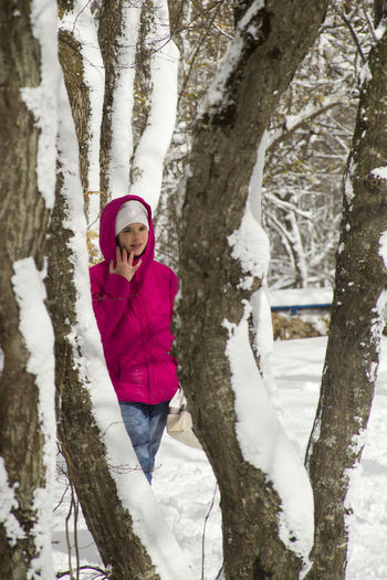 Bare Tree Cold Covering Frozen Girl Leisure Activity Nature Outdoors Snow Snow Covered Snowcapped Tranquil Scene Tranquility Tree Tree Trunk Warm Clothing White Color Winter Telling Stories Differently