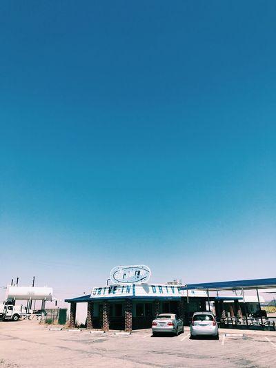 Cars against blue sky