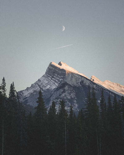 "First Light over the Heart of the Canadian Rockies. EyeEm Best Shots EyeEm Nature Lover If Trees Could Speak Astronomy Beauty In Nature Canada Canon Canonphotography Clear Sky First Light Moon Mountain Mountain Range Nature Outdoors Scenics Snow ""If Trees Could Speak"" The Week On EyeEm Editor's Picks"