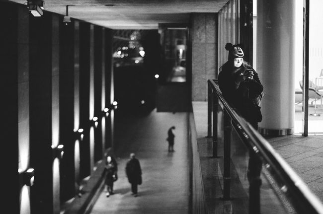 Architecture Atrium Film Railing Architecture Black And White Bw Candid Day Film Camera Film Photography Full Length Indoors  Leaning Lifestyles One Person People Railing Real People Street Street Photography Streetphoto_bw Streetphotography Texting Women