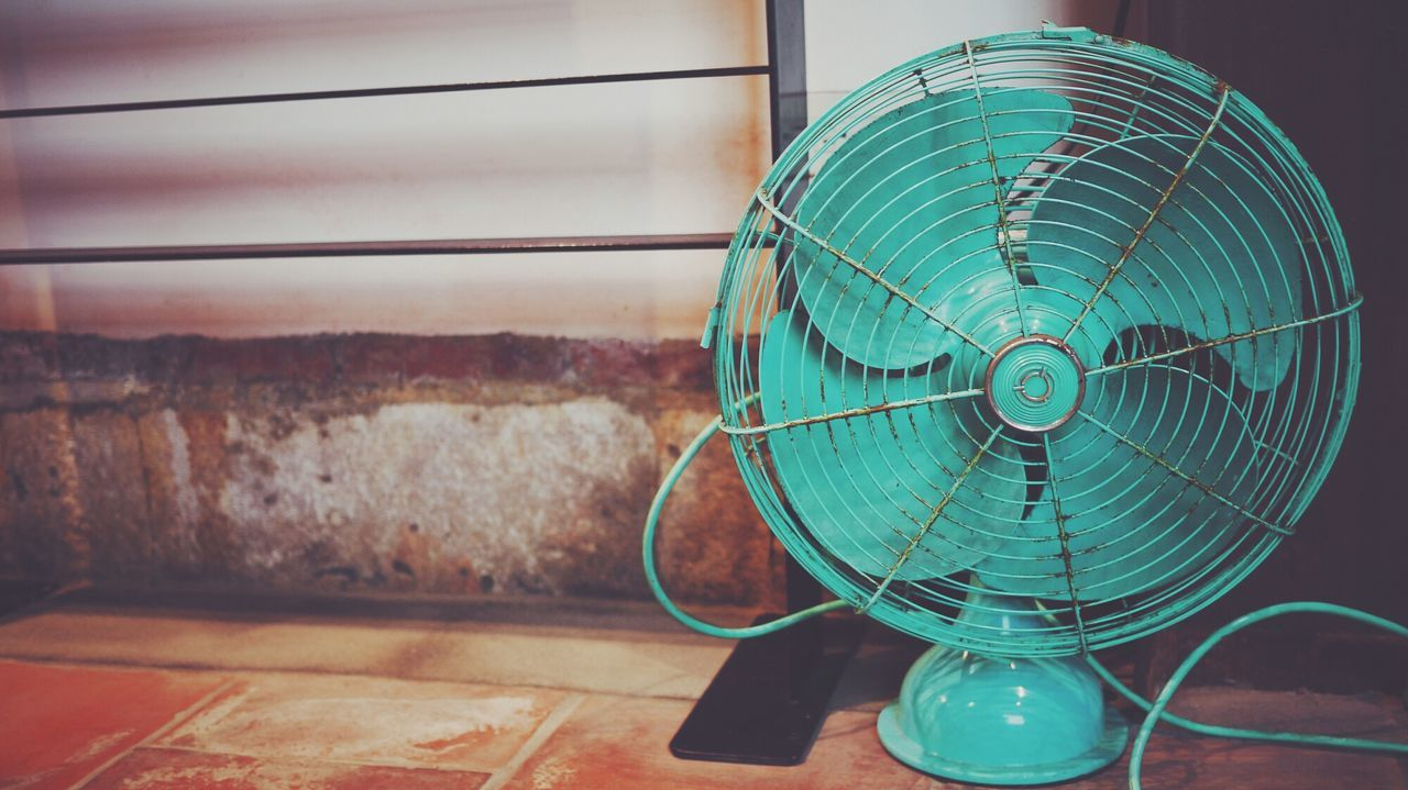 Close-up of green electric fan