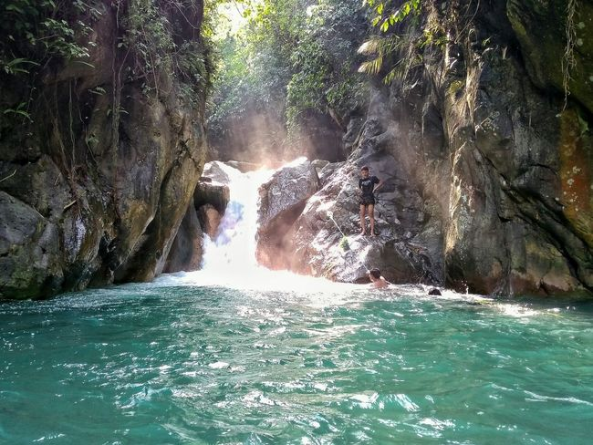 Water Day Nature Sunlight Real People One Person Outdoors Motion Beauty In Nature Swimming People Healthy Lifestyle EyeEmNewHere Indonesia_photography Indonesian Shooter Sunlight Beauty In Nature Refreshment Waterfall Relaxation Swimming Pool Standing Low Section Lifestyles Nature Second Acts Perspectives On Nature