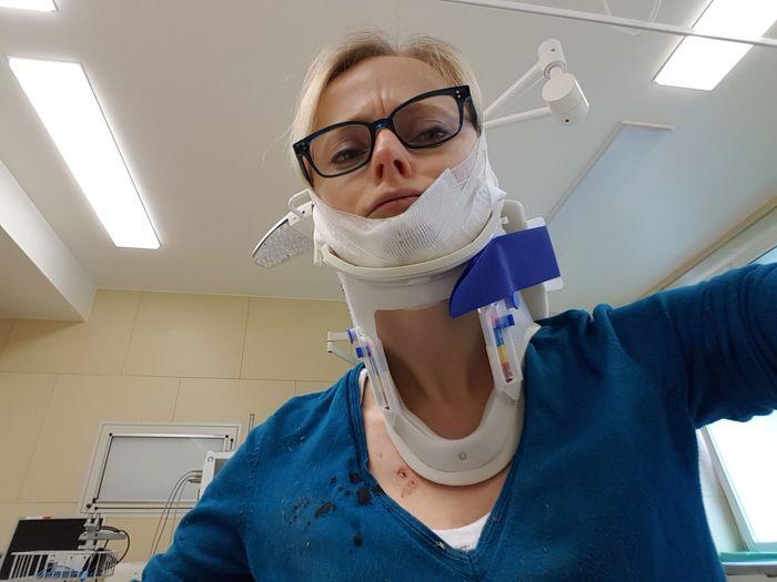 Portrait of young woman wearing neck brace