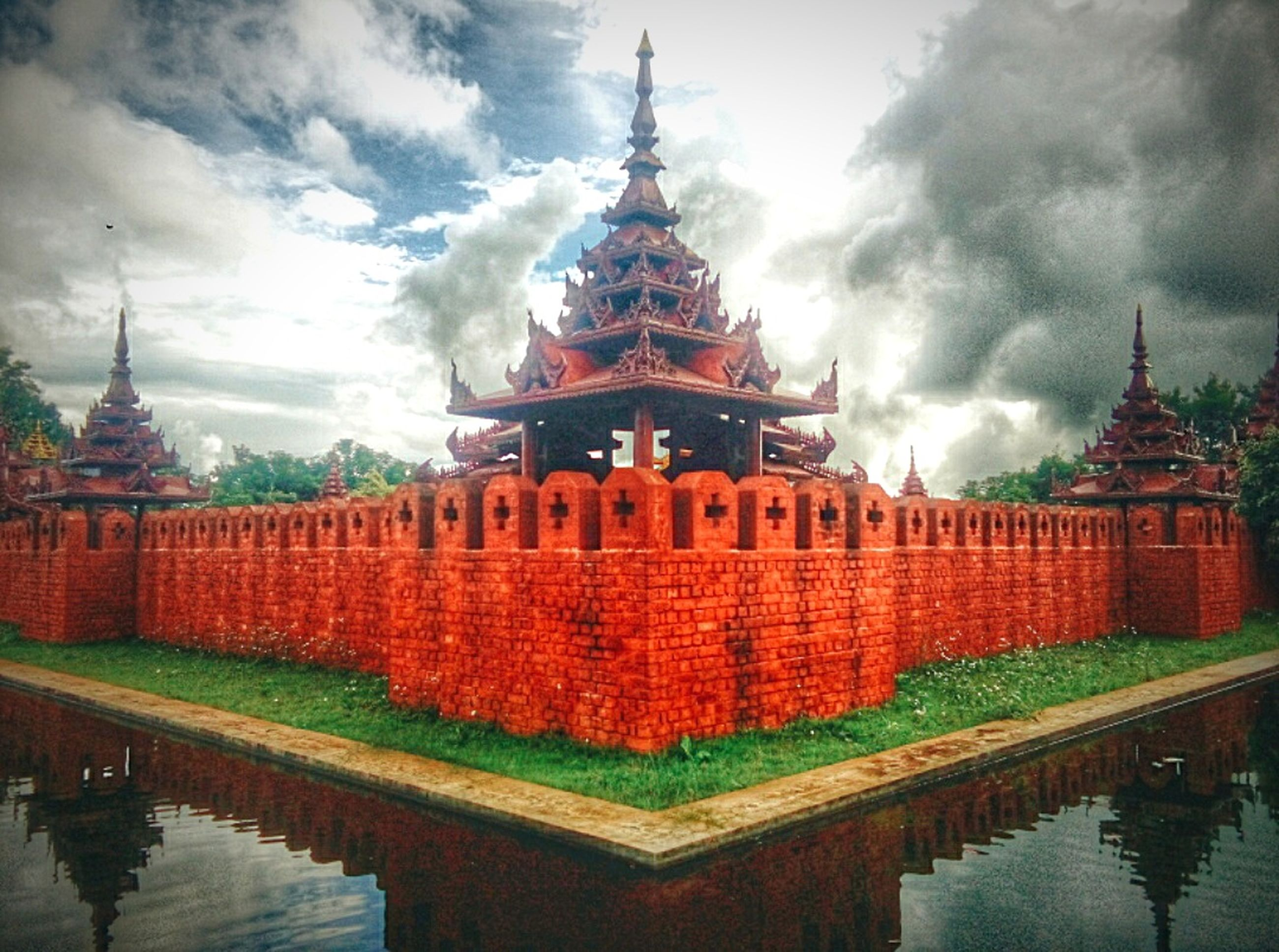 place of worship, religion, spirituality, architecture, built structure, temple - building, building exterior, famous place, sky, travel destinations, tourism, travel, cloud - sky, temple, cathedral, gold colored, international landmark, cloudy