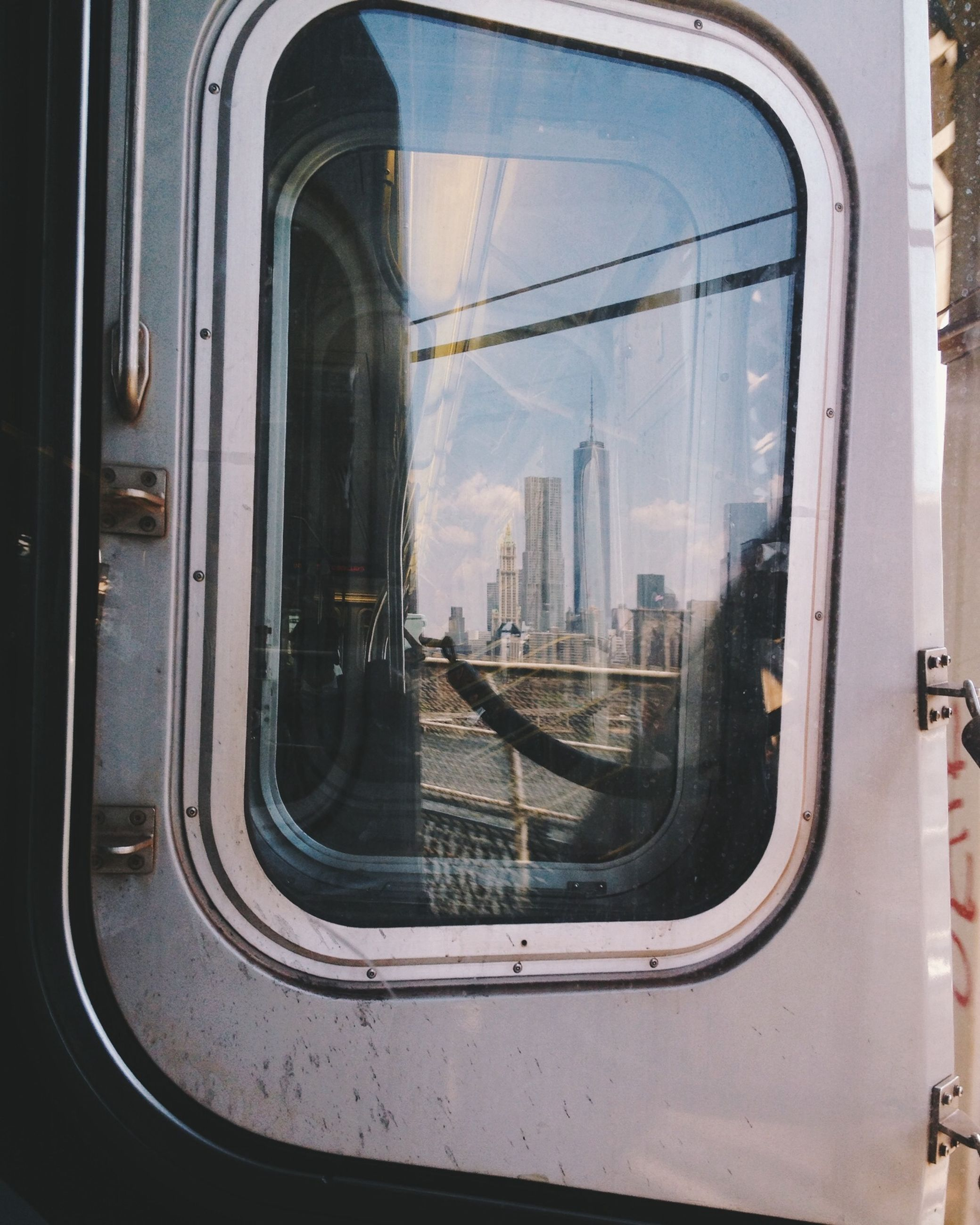 transportation, mode of transport, architecture, glass - material, window, built structure, car, vehicle interior, land vehicle, travel, city, public transportation, building exterior, transparent, indoors, train - vehicle, reflection, sky, looking through window, modern