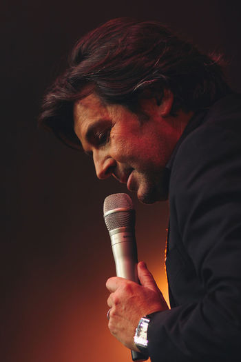 Thomas Anders on a public Fan Club Party concert in February 2009, Koblenz, Germany Artist Famous Fan Club German Man Meeting Modern Music Show Stage Thomas Anders Concert Evening Lightning Live Microphone Musician One Person Party Person Popular Photos Portrait Talent Talking