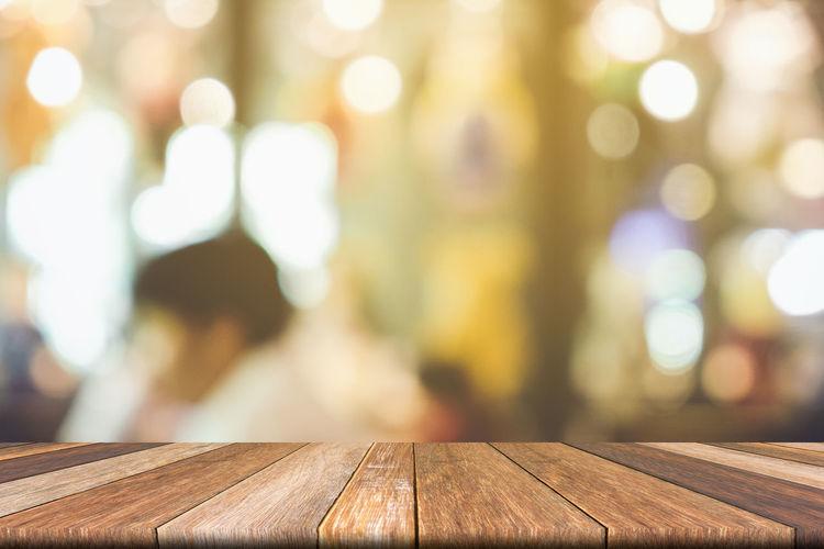 Defocused image of wooden table