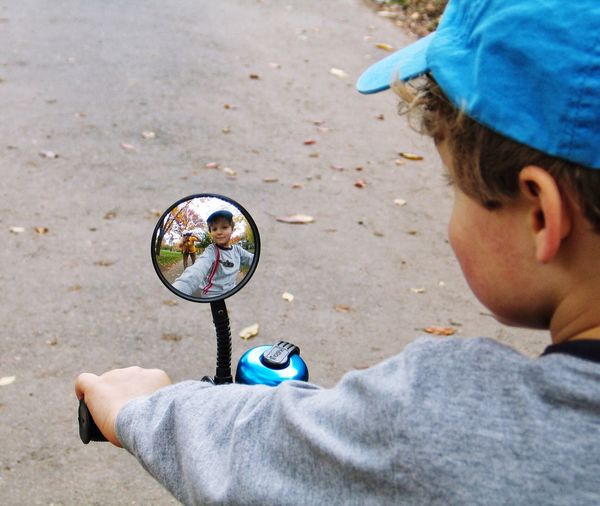 Real People One Person Boys Childhood Outdoors Lifestyles Day Holding Headshot One Boy Only Leisure Activity Cap Sport Child Close-up People Bike Mirror