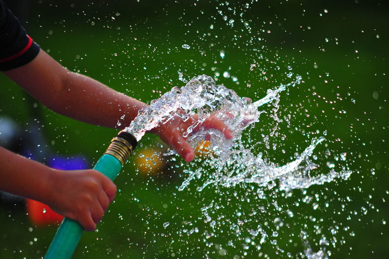 Close-up Day Freshness High-speed Photography Holding Human Body Part Human Hand Leisure Activity Lifestyles Motion One Person Outdoors People Real People Splashing Spraying Water Live For The Story Sommergefühle
