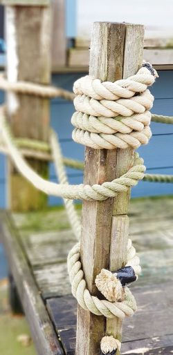 wrapped Rope Art Knotted Rope Wooden Post Decking Wood Weathered Texture Wood Cabin Beachphotography Beach Hut Rope Art Seaside Beach Harbor Moored Water Strength