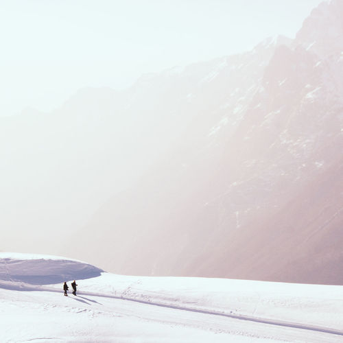 Snow Winter Cold Temperature Mountain Beauty In Nature Scenics - Nature Environment Day Mountain Range Landscape Non-urban Scene Sport Nature Winter Sport Leisure Activity Adventure White Color Snowcapped Mountain One Person Outdoors Lost in the Landscape Alps French Alps Hiking Walking Hikers Cloudy Silhouette The Minimalist - 2019 EyeEm Awards