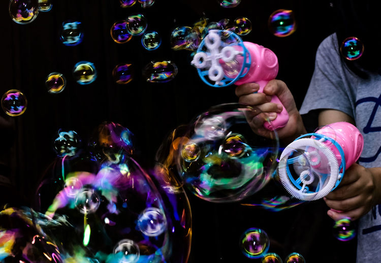 High angle view of woman with bubbles