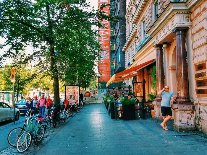 Mann Street - Helsinki, Finland - 14 August 2018 . . . . #summerinhel #snapseed #august #august2018 #nordic #baltic #myhelsinki #lifeinhelsinki #snapseed #helsinki #finland #suomi #mannerheimintie #iguana #iguanahelsinki #summer #summer2018 #streetlife #helsinkistreets #motog6plus Summerinhel Snapseed August August2018 Nordic Baltic Myhelsinki Lifeinhelsinki Helsinki Finland Suomi Mannerheimintie Iguana Iguanahelsinki Summer Summer2018 Streetlife Helsinkistreets Motog6plus City Full Length Bicycle Women Tree Architecture Visiting
